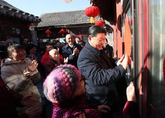 习近平春节前夕在北京看望慰问基层干部群众